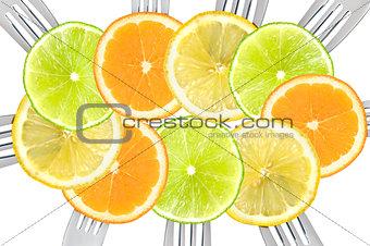 citrus fruit sliced on forks