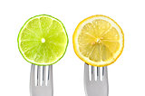 lime and lemon on forks isolated
