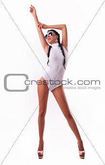 happy beautiful woman with long hair in a white swimsuit on a wh
