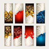 Set of colorful Gift cards with gift bows with ribbons. Vector