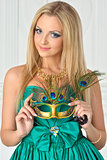Beautiful woman in evening gown with carnival mask.