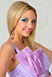 beautiful blonde woman in violet gown.