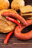 pepper sausage and bread as a food background