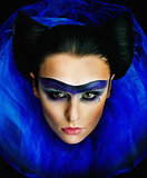 Imposing young lady with bright make up closeup portrait