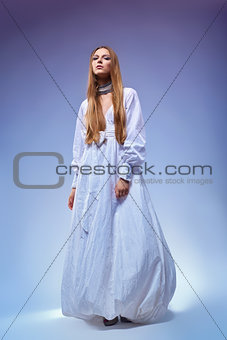 Portrait of romantic young woman in gown dress. Retro style