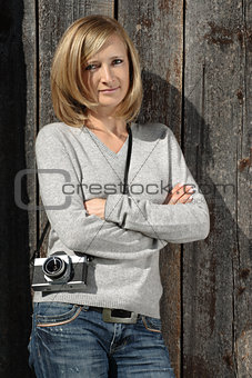 Blond with antique camera