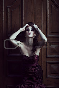 Beautiful woman in violet dress