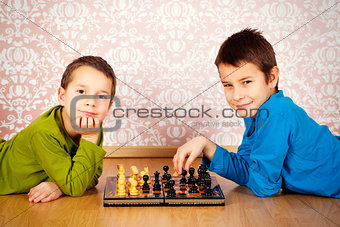 young boys playing chess