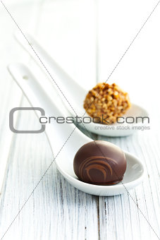 chocolate pralines in ceramic spoon