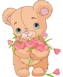 Teddy bear giving hearts bouquet