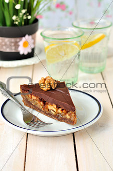 A piece of chocolate caramel tart