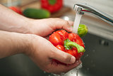 man washing vegetables