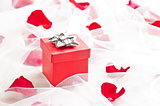 Red Gift box with silver bow on wedding veil 