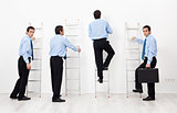 Employees climbing the corporate ladders