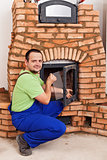 Mason building masonry heater
