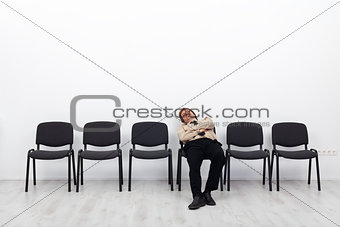 Tired businessman waiting