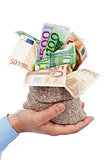 Euro banknotes in small burlap sack