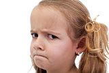 Untrustful little girl looking suspiciously
