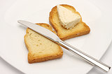 rusk bread slice, cheese and knife
