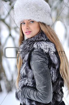 Fur fashion hat. Beautiful girl in furry hat. Winter woman portr