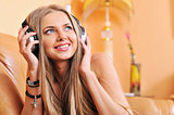 Relaxed woman listening to music in the living-room at home