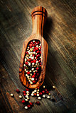 pepper in wooden scoop