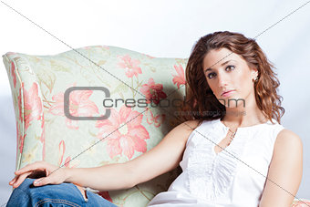 Attractive woman in the armchair