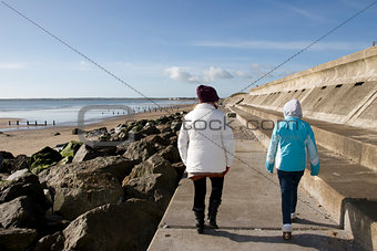 mother and daughter on beach promenade