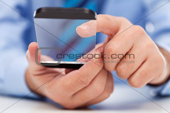 Touchscreen gadget in businessman hands