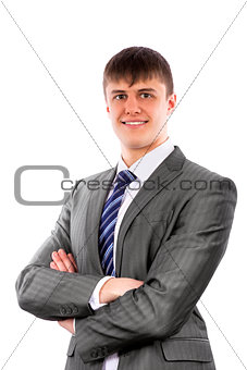Young businessman poses confidently with crossed arms
