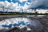 Cloudy Sky Reflected in Huge Road Puddle near Moscow, Russia