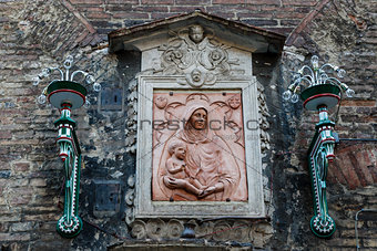 Madonna and the Child Relief in Siena, Tuscany, Italy