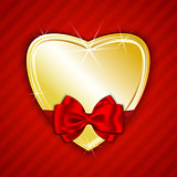 Golden shiny heart on red background