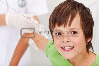 Happy boy receiving vaccine or injection