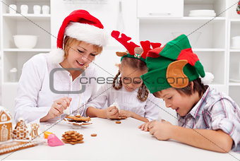 Happy christmas family decorating gingerbread cookies
