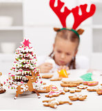 Girl decorating gingerbread cookies