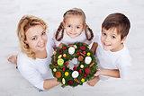 Woman with two kids holding advent wreath