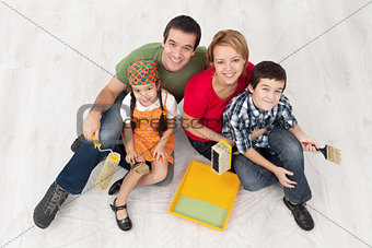 Family with two kids ready to pait their home