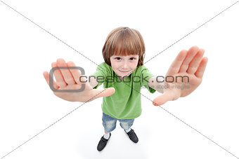 Little boy showing his palms framing the view