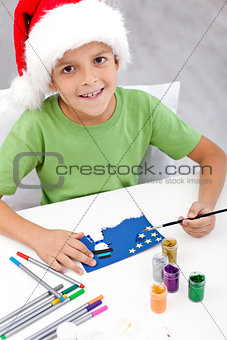 Boy making christmas card