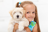 Little girl with her fluffy dog
