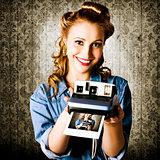 Smiling Young Vintage Girl Taking Polaroid Photo