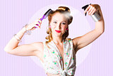 Classic 50s Pinup Girl Combing Hair Style