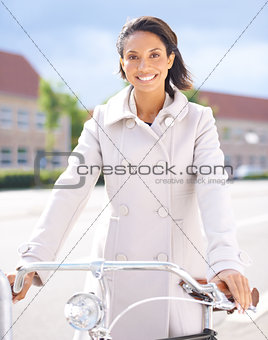 Exploring her new town by bike