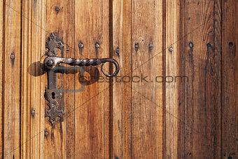 Ancient door handle on old door