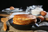 Oatmeal pancakes in a frying pan.