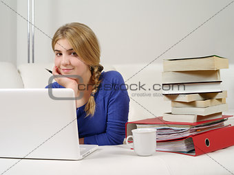 Pretty teenager doing homework