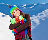 Happy girl with Christmas gift, winter outdoor portrait