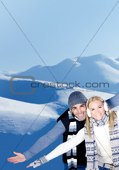 Happy couple playing outdoor at winter mountains