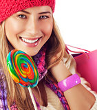 Young lady with colorful lollipop